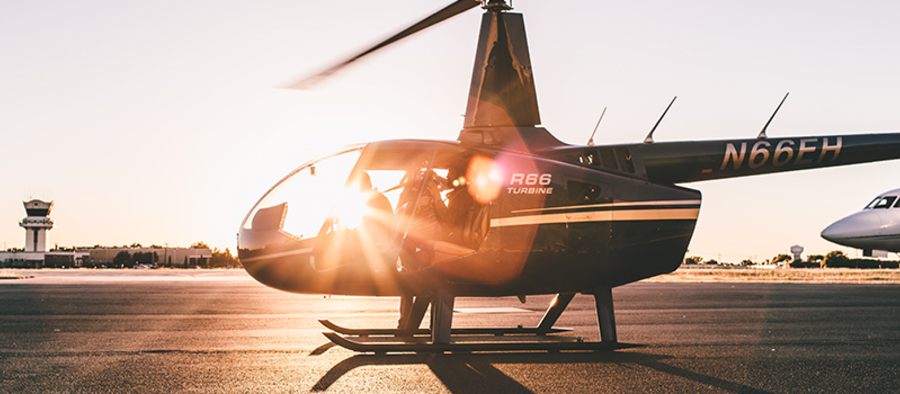 Helicopter glistening in the sunset or sunrise.