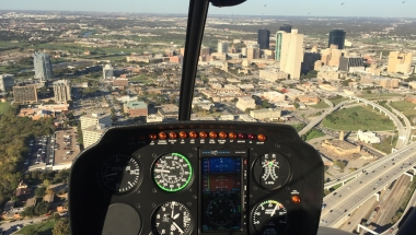 Training helicopter flying over downtown Fort Worth