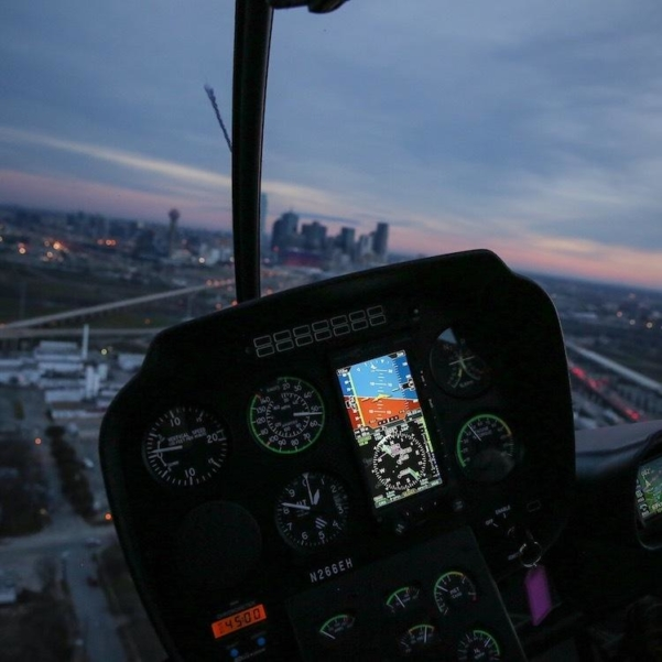 Cockpit of Robinson R66 at night